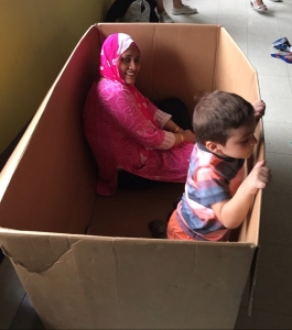 Student and parprofessional playing in a box
