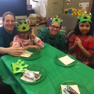 P7 Girls Club teachers with students at St. Patrick's Day party