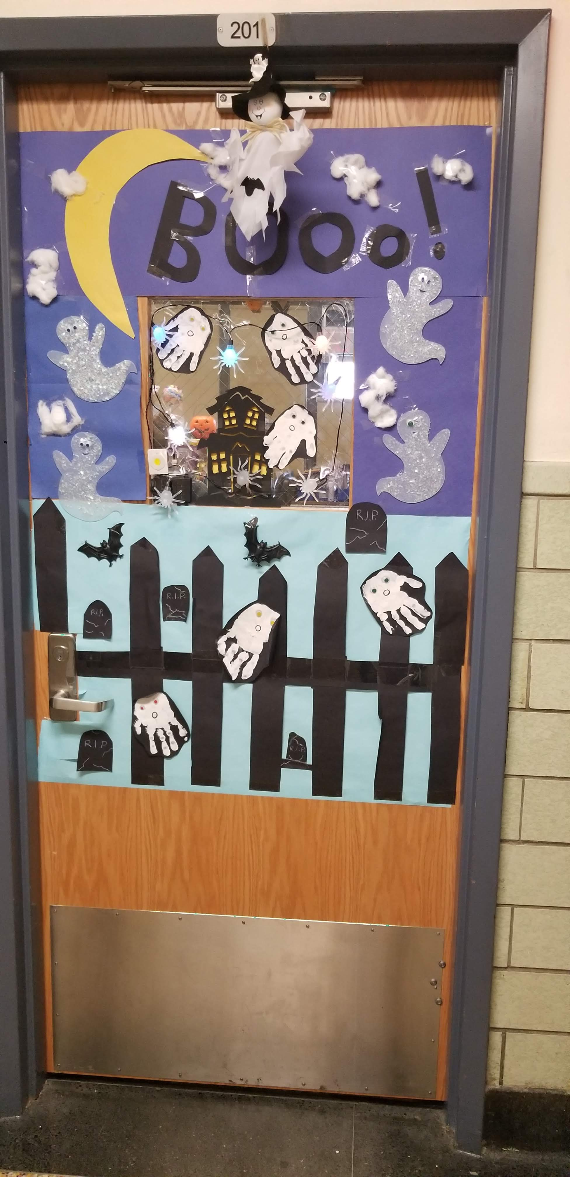 Classroom door decorated with student work ghost hands.