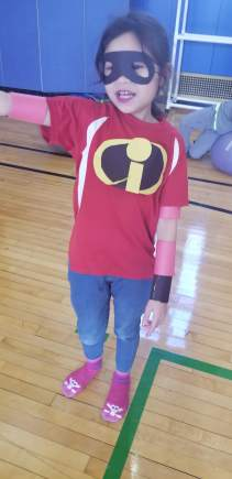 Small girl dressed in Incredibles costume