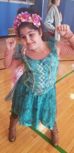 Little girl dressed up in unicorn costume.