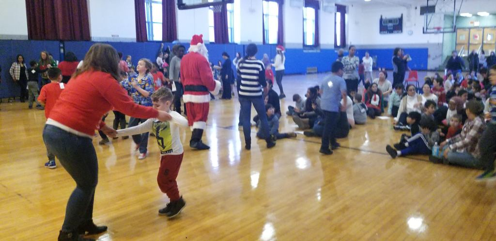 Children dancing with Santa