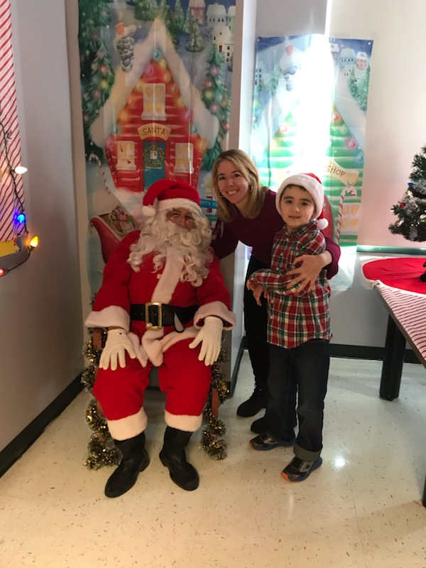 Student smiles with Santa
