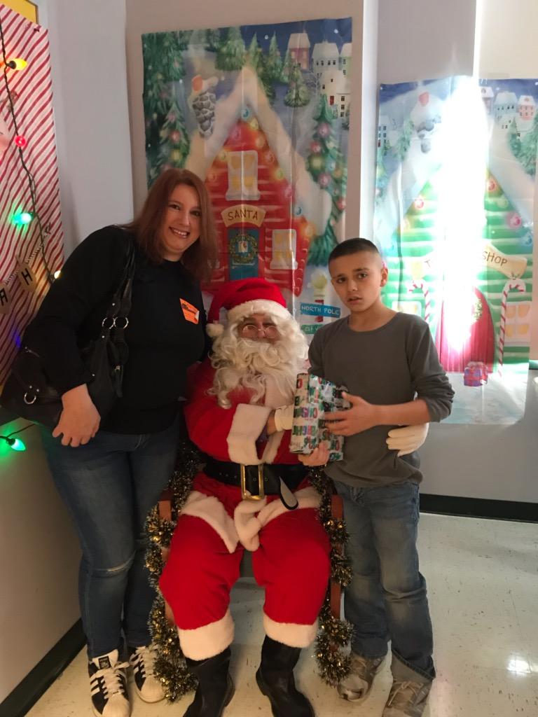 Student smiles with Santa