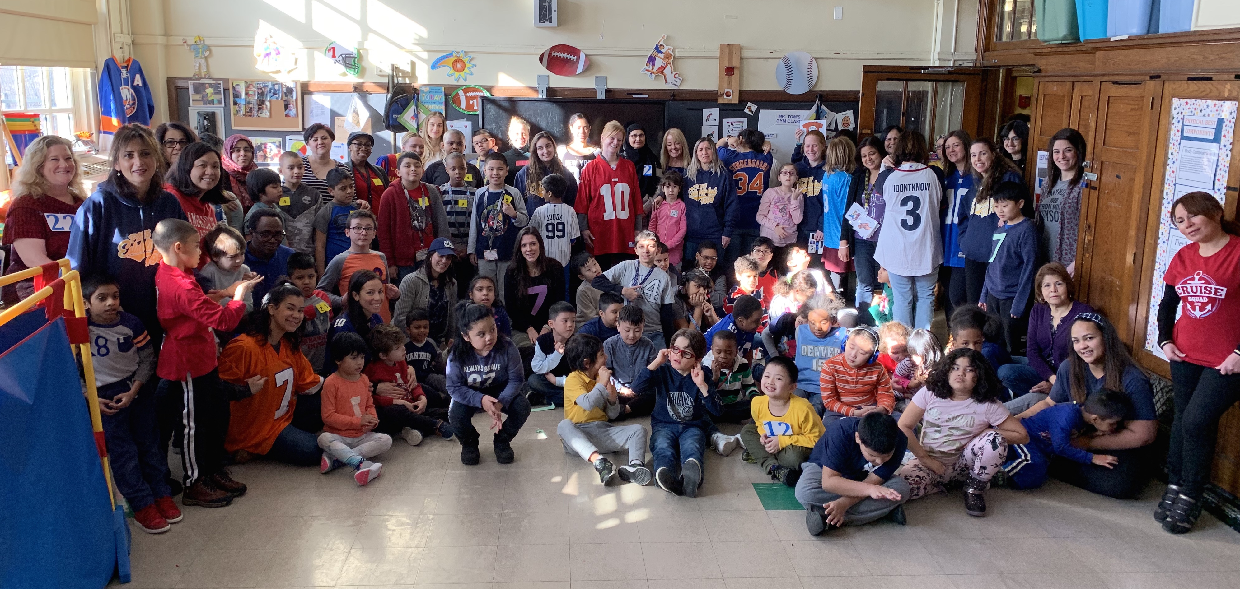 "Students and staff of 154 pose in their numbered clothing for ""Everyone Counts"" day"