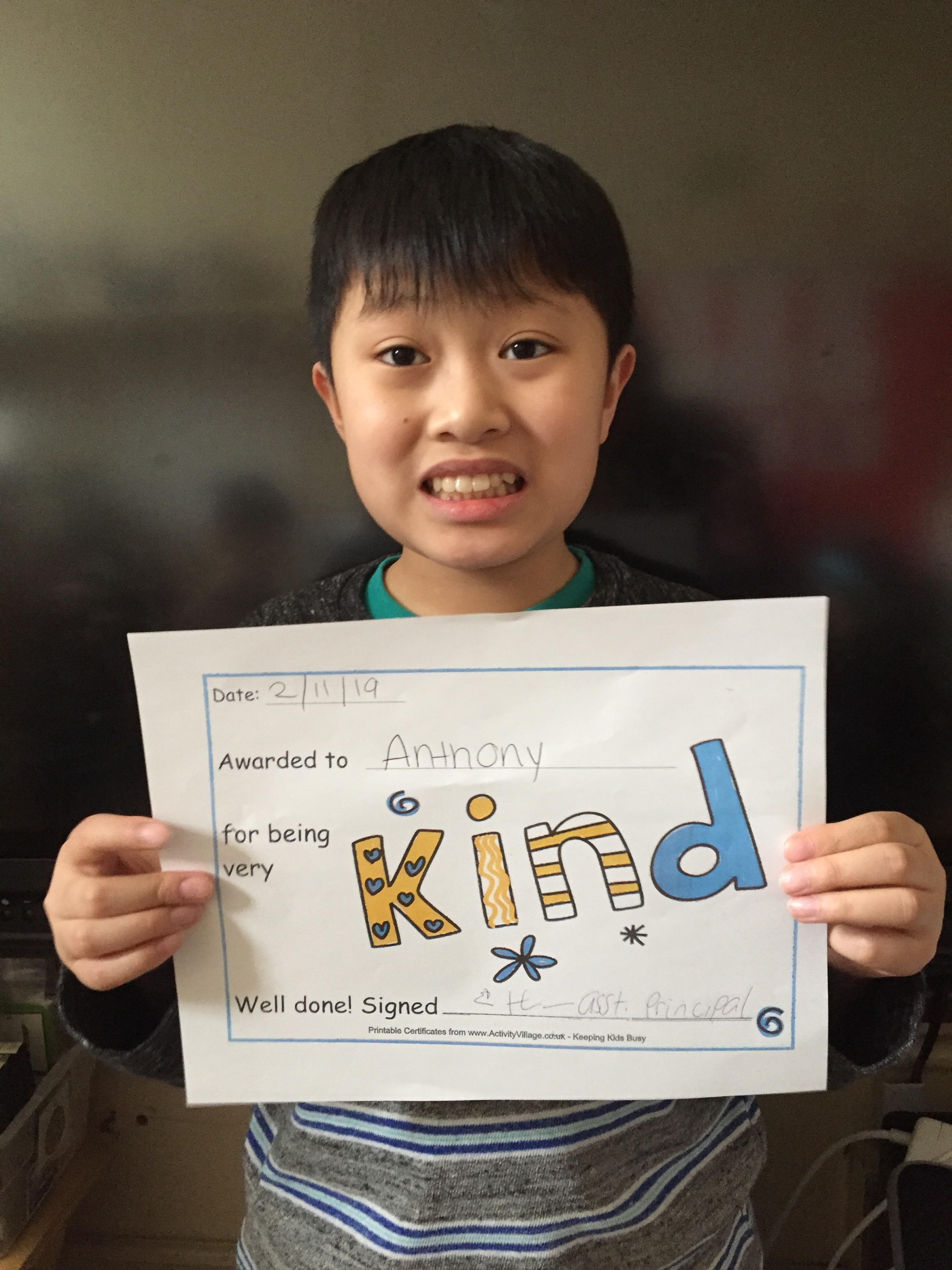 student holds up certificate