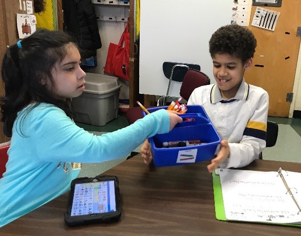 two students sharing supplies