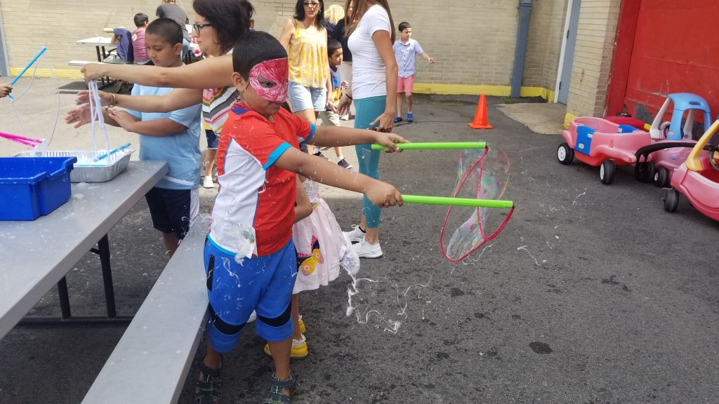 Boy in mask makes giant bubble.
