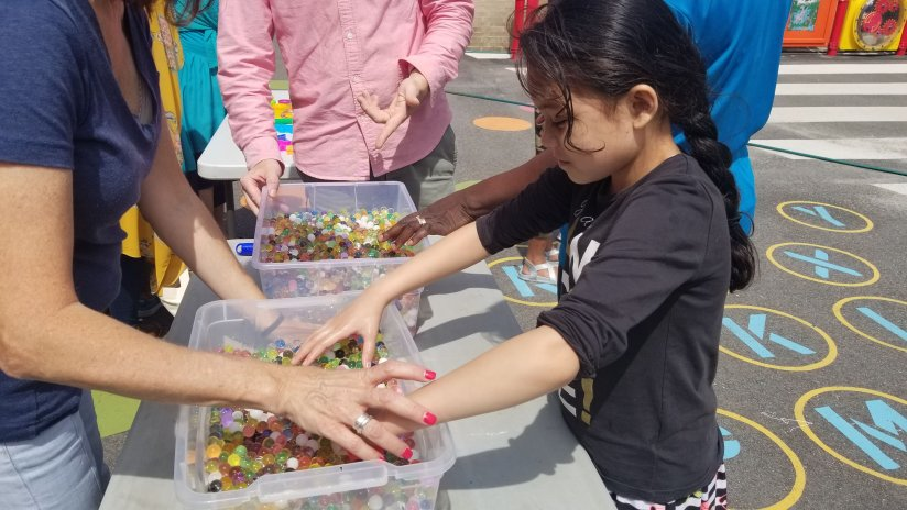Girl plays with jelly beads