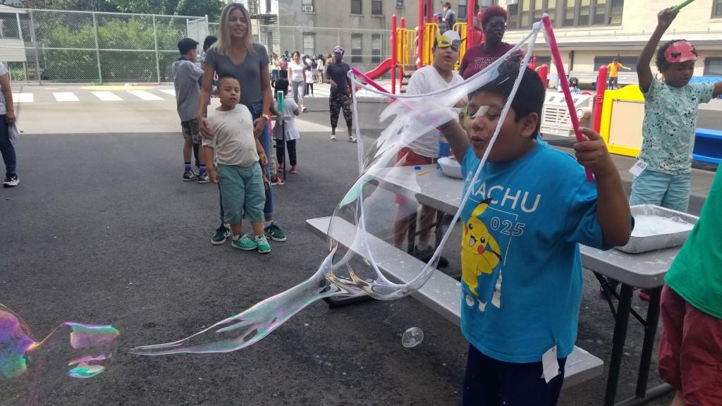 Boy blows giant bubble