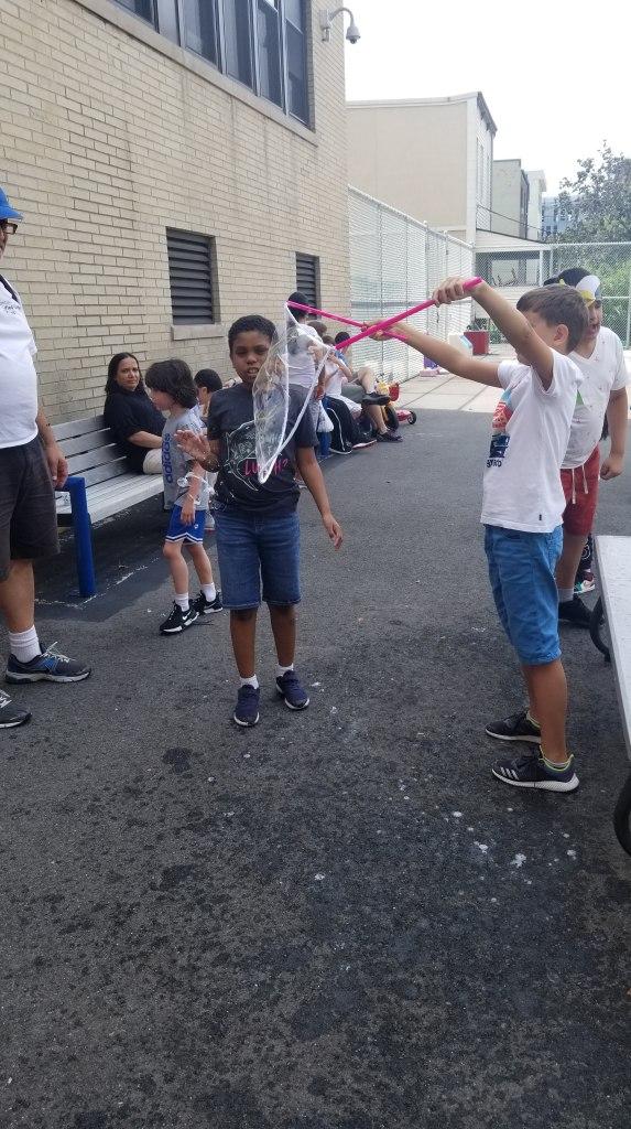 Boy makes giant bubble