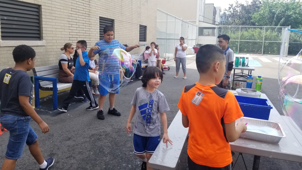 Boys make bubbles at carnival