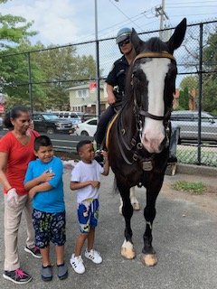 Students admire police horse.