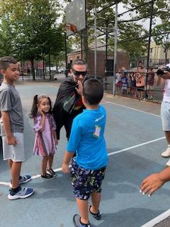 Superhero robin meets students