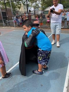 Child hugs Robin
