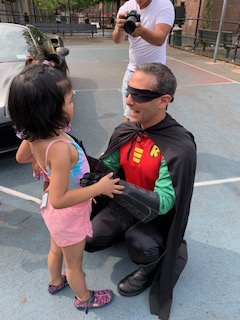 Robin greets young girl.