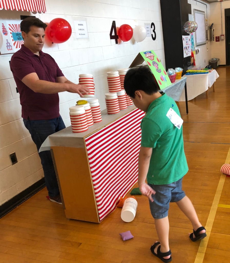Boy plays stacking cups game.