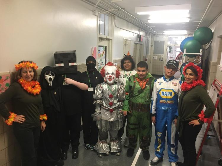 Children and staff dressed up as Turtle, Scream, Pennywise, Racecar driver and flowers
