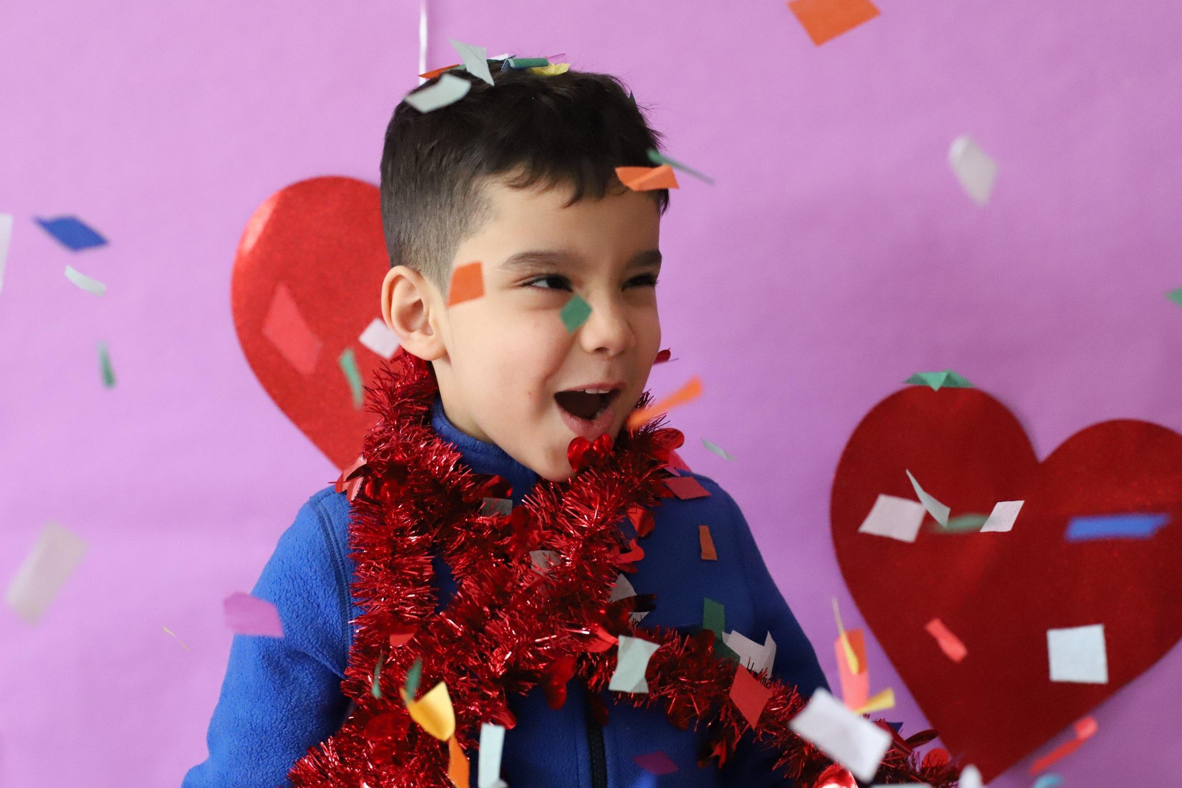 boy surrounded by hearts