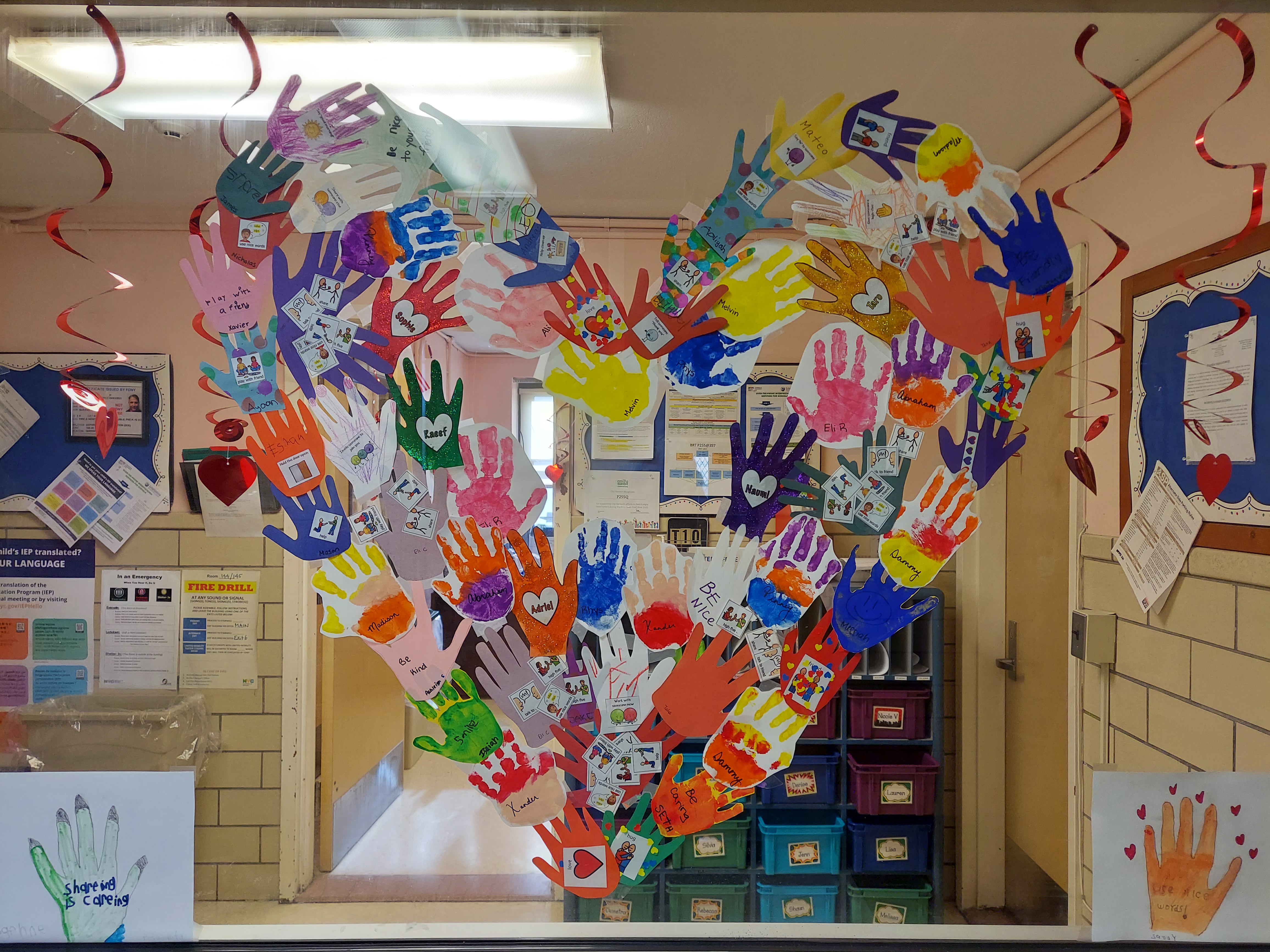 Heart made of painted hands