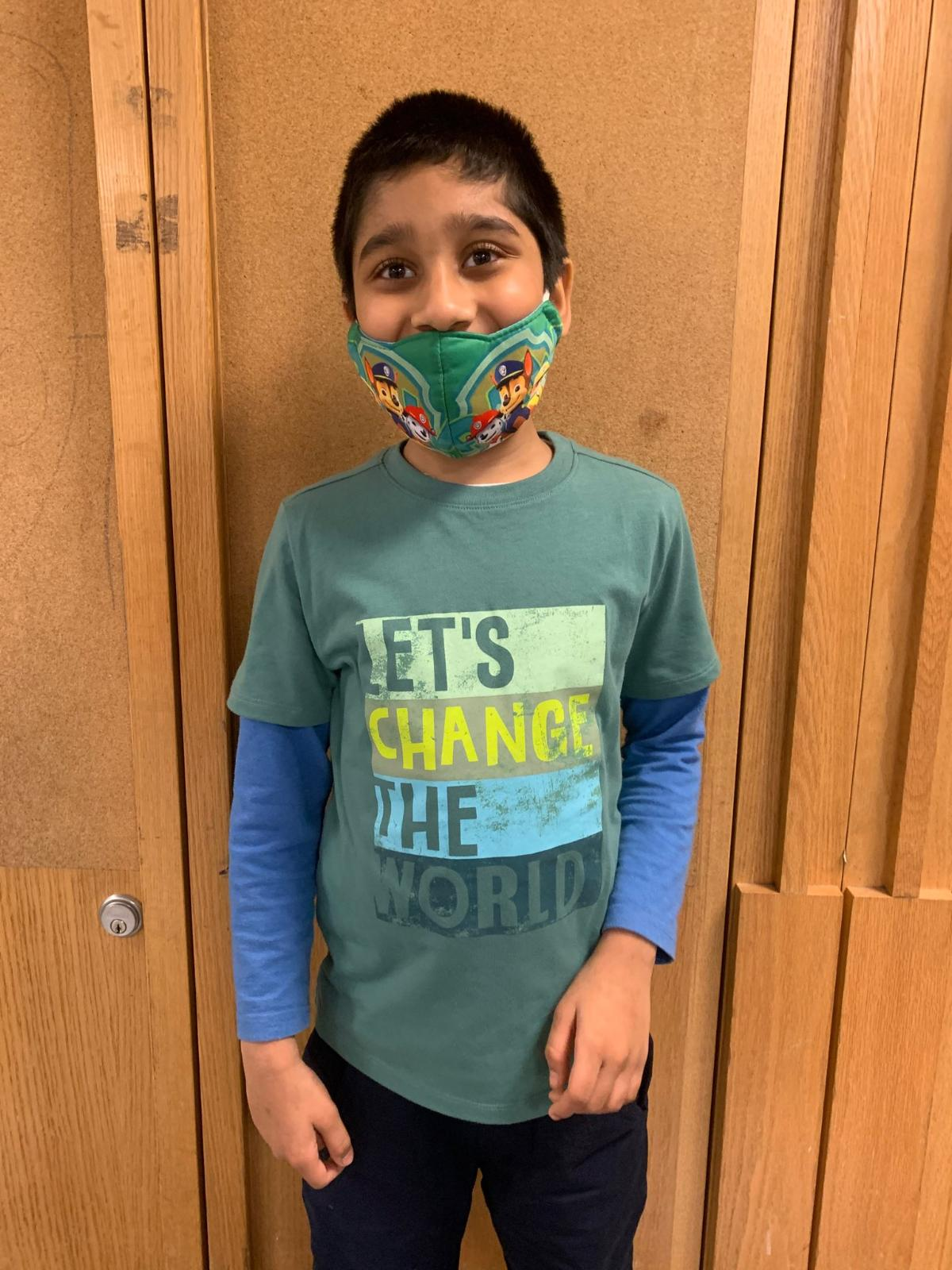 Boy wearing let's change the world tee.